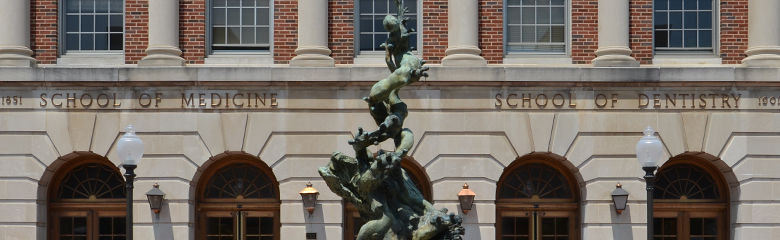 Photo of statue in front of Georgetown University School of Medicine building